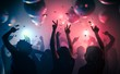Young happy people are dancing in club. Nightlife and disco concept.