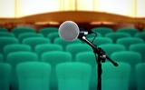 Seminar presentation background with microphone and seat