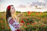 Ukrainian woman in the poppy field