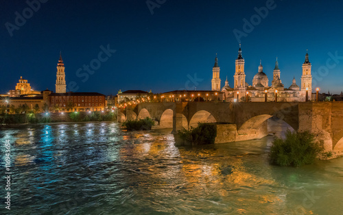 Basilica Our Lady Pillar In Zaragoza And the Bridge In Spain At Night