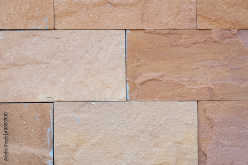 decorative uneven real stone wall surface with cement, stone wall background