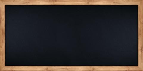 wide blackboard with wooden bamboo frame / Breite Kreidetafel mit Holzrahmen aus Bambus © stockphoto-graf