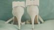 Постер, плакат: Close up of a brides wedding shoes