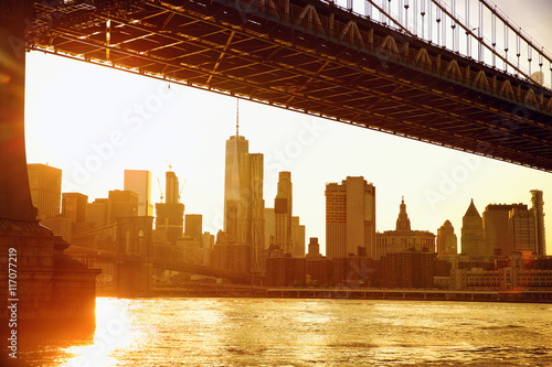 Lower Manhattan skyline under Manhattan Bridge at sunset, New York