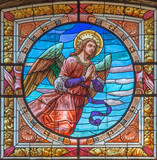 CREMONA, ITALY - MAY 24, 2016: The angel on the stained glass in church Chiesa di Santa Agata by Don Abate Agostino Desirelli from end of 19. cent.