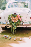 Fototapety Vintage wedding car with just married sign and cans attached, close-up