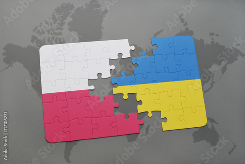 Foto op Canvas Kiev puzzle with the national flag of poland and ukraine on a world map background.