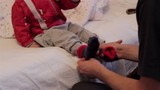 wear socks to baby/Dad puts his young son on his feet socks