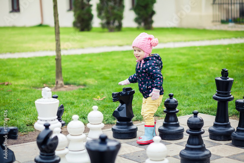 Poster girl playing with giant chess