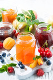 assortment of sweet jams and seasonal fruits, vertical