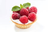 mini cake with cream and fresh berries