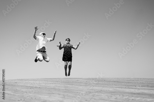 senior couple jumping Poster