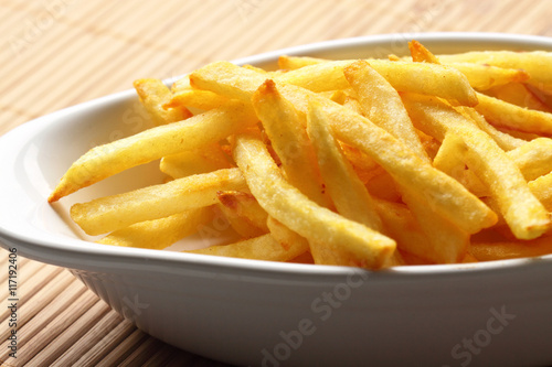 Poster Fries chips bowl / French fries in a white bowl