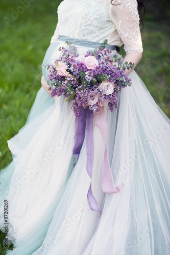 Zdjęcia na płótnie, fototapety, obrazy : lilac bouquet in hands of the pregnant girl