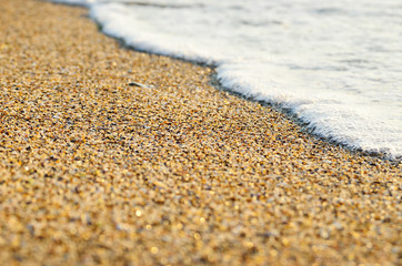 Tidal wave on a clean, sandy, sea beach