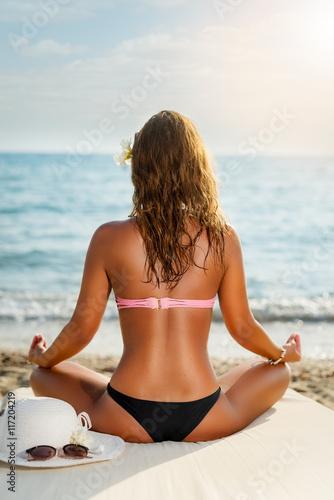Leinwand Poster Yoga auf dem Strand