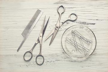 Vintage tools of barber shop on light wooden background