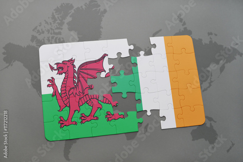 puzzle with the national flag of wales and ireland on a world map background Poster
