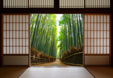 Travel background of Japanese rice paper doors opened to a peaceful bamboo forest path