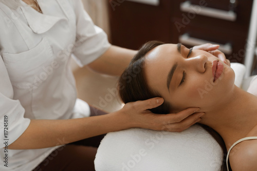 Poster Spa Massage. Beautiful Woman Getting Facial Beauty Treatment