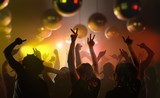 Nightlife and disco concept. Young people are dancing in club.