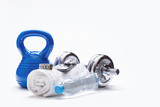 Fototapety Fitness Equipment. Kettlebell towel dumbbells water smart phone with headphones and measuring tape.