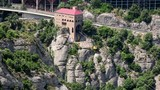 A cableway cabin approaching its terminal point at the Montserrat monastery, Spain, Catalonia