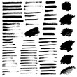 Set of different grunge brush strokes and stains.