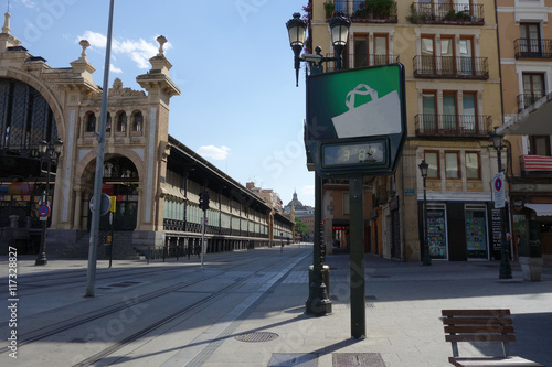 an empty street of Saragossa in summer with a thermometer showing 38 degrees