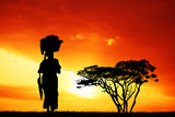 African woman silhouette at sunset