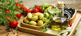 Mediterranean ingredients with olive oil and olives, spices and - 117366077