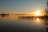 Sunrise on the lake with haze.