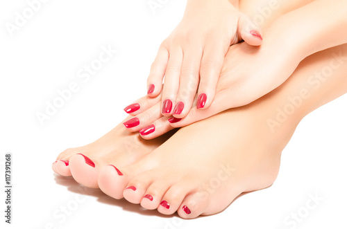 Papiers peints Pedicure Beautiful foot and hands with red manicure