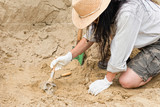 Archaeology work. Archeologist carefully cleaning ancient human remains