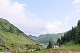 Photo of green capra peak, and a road in fagaras mountains, Romania.