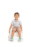 Smiling kid sitting on a chair