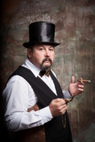 A man in a bowler hat with a cigar