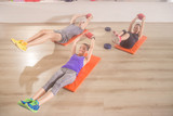 Three people fitness mat happy abs core exercise straight arm we