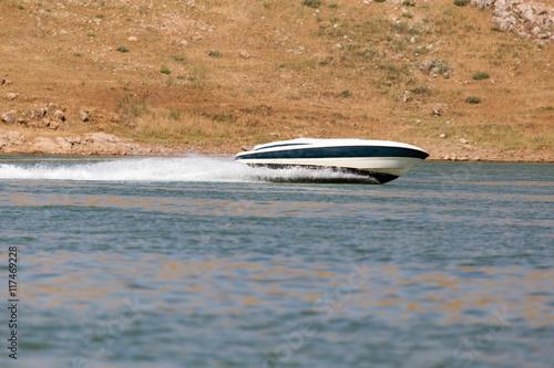 Papiers peints Nautique motorise Boat floats on the lake speed