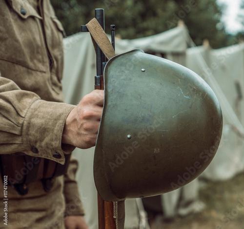 Poster Historical reconstruction second world war. Helmet hangs on the