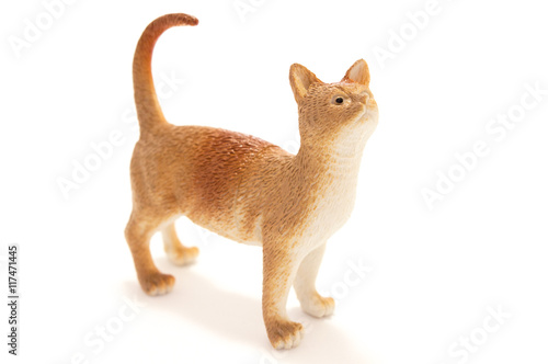 Poster Toy cat from plastic on a white background.
