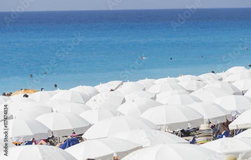 Foto op Plexiglas Indonesië white umbrellas in Kathisma beach, Lefkada island, Greece
