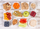 Fototapety Healthy snacks on wooden table, top view