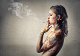 Beautiful tattooed woman smoking