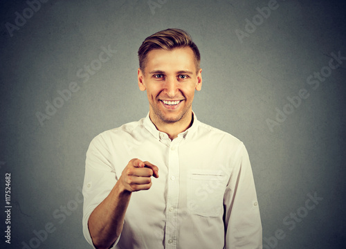 Poster Portrait of a young man pointing his finger at you