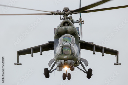 obraz lub plakat Front view of a flying attack helicopter