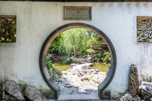Fototapeta Traditional Chinese garden white round entrance. Yuyuan Chinese