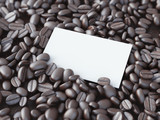 Blank white business card in coffee beans. 3d rendering