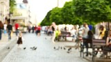 Slow motion .Unknown people on European city street. Blurred scene
