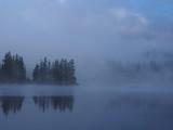 Summer mountain lake Strbske Pleso in fog